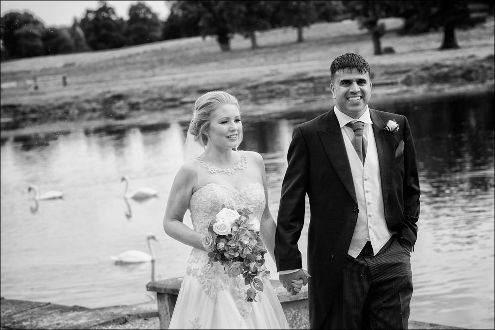 bride and groom by lake, Capesthorne Hall